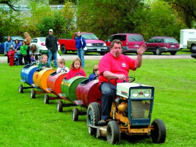 Kids take a ride on the Tractor Train